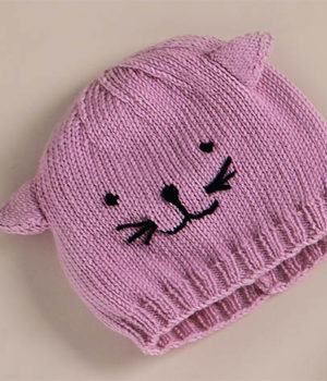 РОзовая шапка с ушками для девочки